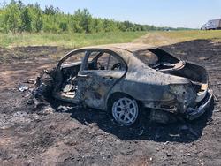 Мерседес столкнулся с двумя фурами и сгорел, водитель погиб